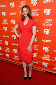 Emily Deschanel chose a simple red carpet look with this red sheath dress when she attended the FXX Network launch.