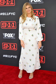 Connie Britton paired her frock with nude slim-strap heels.