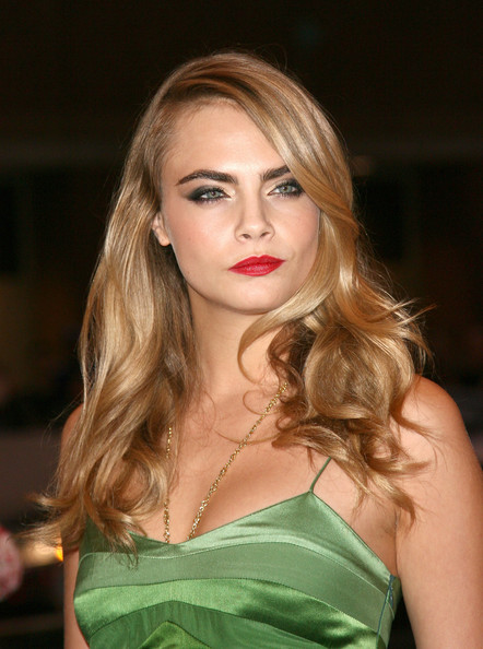 Cara Delevingne's bold red lips contrasted nicely with her green dress.
