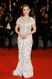 Jessica Chastain cut a regal figure in a beaded white and gold gown by Chanel at the Cannes Film Festival screening of 'In the Fade.'