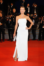 Natasha Poly was all about summertime charm in a custom white Boss gown with spaghetti straps and ruffle detailing at the Cannes Film Festival screening of 'In the Fade.'