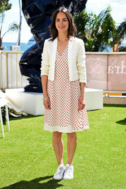 Berenice Bejo teamed her dress with a white cropped jacket.