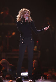 Faith Hill worked the stage in Melbourne wearing these sleek black pants with gold buttons.