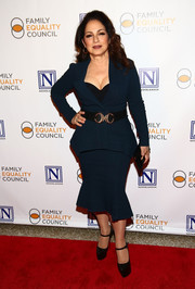 Gloria Estefan chose a navy jacket and fluted skirt combo for the Night at the Pier event.