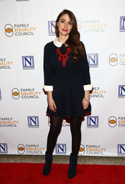 Sara Bareilles finished off her outfit with a pair of navy ankle boots.