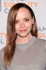 Christina Ricci chose a deep side part for her sleek and sophisticated evening look.