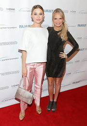 Olesya Rulin chose a silver snakeskin bag to add some texture to her red carpet look.