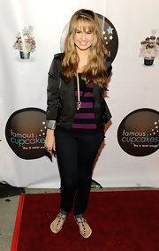 Debby Ryan attended the Famous Cupcakes launch party wearing gemstone embellished flat sandals.