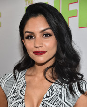 Bianca Santos wore her hair with a deep side part, a teased top, and wavy ends during the fan screening of 'The Duff.'