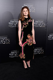Bonnie Wright charmed in a Prada dress featuring oversized floral embroidery during the world premiere of 'Fantastic Beasts and Where to Find Them.'