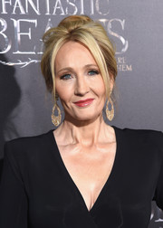 J.K. Rowling attended the world premiere of 'Fantastic Beasts and Where to Find Them' wearing her hair in a poufy updo.