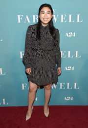 Simple nude pumps completed Awkwafina's look.