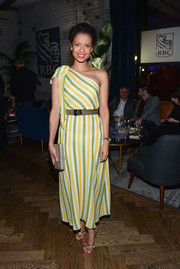 Gugu Mbatha-Raw teamed her frock with strappy silver heels.