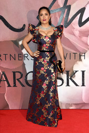 Salma Hayek went the ultra-feminine route in a Gucci floral-embroidered gown with a low neckline and ruffle sleeves at the Fashion Awards 2016.