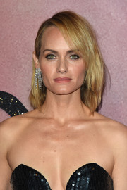 Amber Valletta attended the Fashion Awards 2016 wearing her hair in an edgy lob with side-swept bangs.