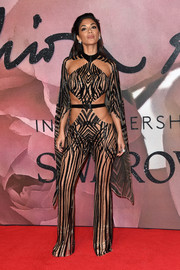 Nicole Scherzinger channeled her inner sex goddess-slash-superhero with this caped, sheer cutout jumpsuit by Julien Macdonald at the Fashion Awards 2016.