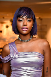 Justine Skye attended the Fashion Awards 2017 nominees reception wearing a purple bob with choppy bangs.