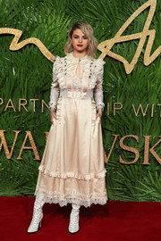Selena Gomez went frilly in a lace-and-ruffle-trimmed champagne satin dress by Coach at the Fashion Awards 2017.