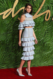 Kaia Gerber matched her top with a tiered blue skirt.