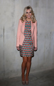 Mollie King worked a loud print at the Fashion East show in London.