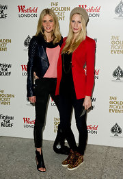Donna wears a black quilted leather jacket with her skinny pants at the Fashion for Relief photocall.