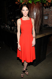 Hilary Rhoda styled her dress with edgy-glam black and gold strappy sandals.