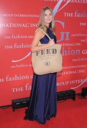 Lauren Bush accessorized her glamorous sapphire gown with an unexpected canvas Feed bag at the Fashion Group International's night of stars.