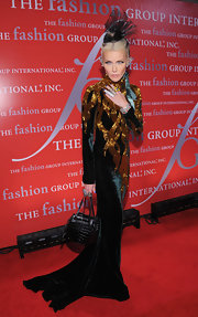 Daphne Guinness looked ready for Halloween in a velvet gown with gold embellishments and a long mermaid train.