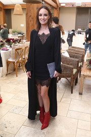 Catt Sadler was sultry in a black lace-panel mini dress by NBD at the StyleWeekOC event.