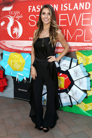 Audrina Patridge attended the StyleWeekOC event wearing a cute black ruffle jumpsuit.