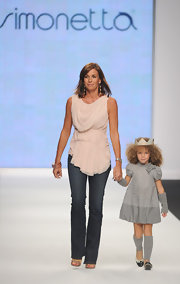 Cristina Parodi sashayed down the runway for charity, she wore a soft chiffon top in a delicate shade of blush.
