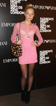 Clara paired her see-through pink dress with a leopard print shoulder bag.