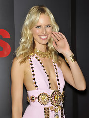 Karolina Kurkova wears loose waves to Fashion's Night Out in New York. To recreate her look, make a center part and curl one-inch sections with a medium-barreled curling iron. To finish, tousle hair with fingers.