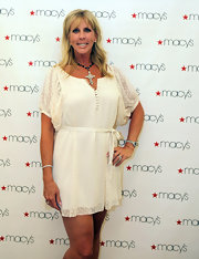Vicki Gunlavson kept it short and sweet in this white-on-white polka dot mini dress.