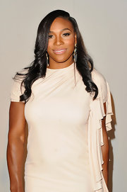 Serena Williams showed off her long curls while hitting Fashion's Night Out Show.