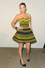Blake topped off her tribal look with matching gold bangle bracelets.