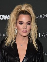 Khloe Kardashian channeled the '80s with this teased high ponytail at the Fashion Nova x Cardi B collaboration launch.