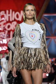 Natasha Poly's distressed 'Child at Heart' tank provided an edgy contrast to her embellished dress on the Fashion for Relief runway.