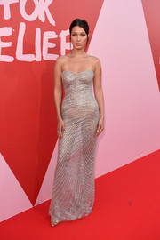 Bella Hadid looked stunning on the Fashion for Relief red carpet in a crystal-embellished strapless gown by Roberto Cavalli Couture that clung so perfectly it looked like it was spray-painted on her body!