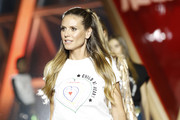 Heidi Klum looked youthful and pretty wearing this half-up hairstyle on the Fashion for Relief runway.