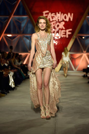 Natalia Vodianova was rocker-glam in a draped chainmail fishtail dress at the Fashion for Relief runway show.