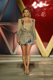 Kate Moss looked quite the glamazon in this short and chic skirt suit by Atelier Versace while walking the Fashion for Relief runway.