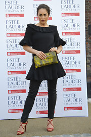 Tallulah Harlech chose a pair of black skinny pants to complete her all-black look while at the Fashion Rules Exhibit.