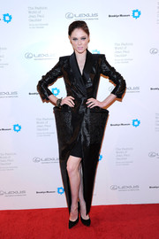 Coco Rocha looked avant-garde in an exaggeratedly shaped black evening coat by Jean Paul Gaultier when she attended the Fashion World of Jean Paul Gaultier reception.