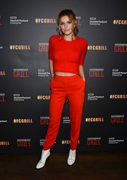 Bella Thorne was in a matchy-matchy mood, pairing her top with tapered red slacks.