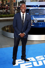Tyrese Gibson chose a midnight blue suit with a small shawl collar for his look at the premiere of 'Fast & Furious 6.'