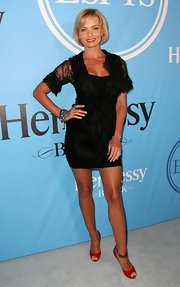 Jaime Pressly paired her red peep toe heels with a lace embellished black dress.