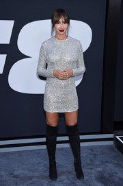Jackie Cruz went for edgy styling with a pair of black over-the-knee boots.