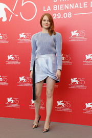 Emma Stone donned a loose pastel-blue blouse by Louis Vuitton for the Venice Film Festival photocall for 'The Favourite.'