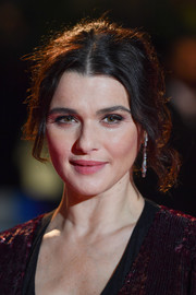 Rachel Weisz sported a messy-glam updo at the UK premiere of 'The Favourite.'